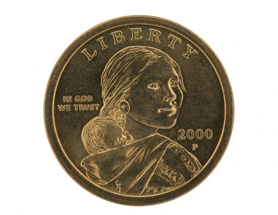 Picture of coin featuring young woman looking over her right shoulder, an infant in a fabric sling on her back. She wears a round earring.
