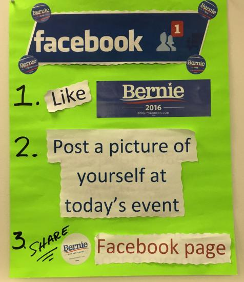 "Photo of green sign with text ""Like Bernie on Facebook"" and more"