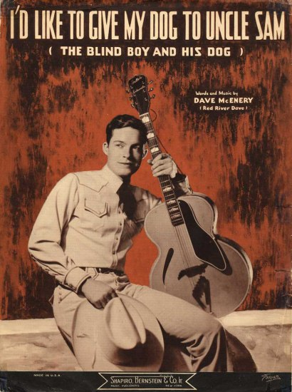 Sheet music with image of man holding guitar, resting head against it. He has a hat in his other hand.