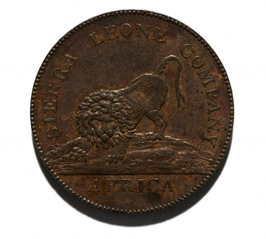 A bronze-colored coin with a crouching lion on one side and text running along the edges