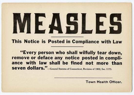 Brownish/white sign enforcing measles quarantine
