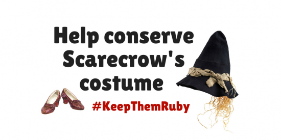 "Graphic including the text ""Help conserve Scarecrow's costume"" and an image of the Ruby Slippers plus Scarecrow's hat."