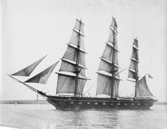Black and white photo of a ship with three masts sailing on the ocean