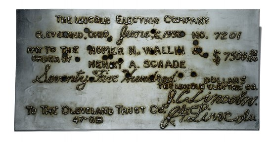 """Steel document in very silver color. Text: """"The Lincoln Electric Company."""""""