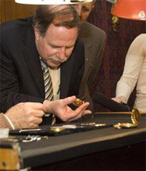 Doug Stiles examining Lincoln's pocket watch