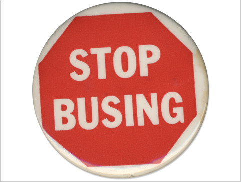 "Photograph of white button bearing a red stop sign that reads: ""Stop Busing."""