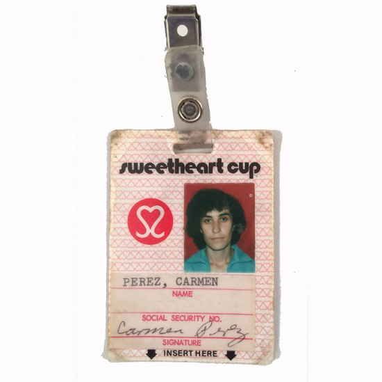 "A pink ID badge for ""Sweetheart Cup."" Carmen Perez's name, signature, and photo is visible."