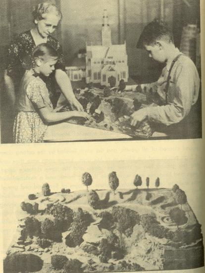 Two black and white photos. Top photo: a little boy and little girl touch Mt. Vernon model with guidance of teacher. Bottom: landscape section of the model, with trees and dirt works.