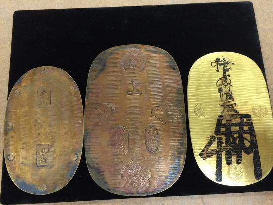 Three oval coins with Japanese writing