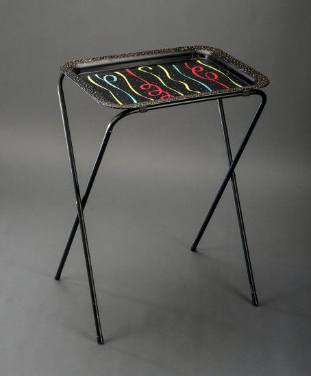 Photo of TV tray with thin metal legs and trays with black background and festive ribbon design