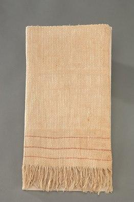 White towel, beige with age, with two reddish stripes and fringe at bottom, neatly folded
