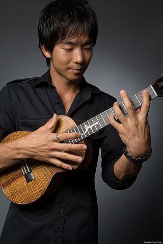 Photography of musician with ukulele