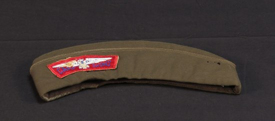 Army green cap with red patch and white eagle
