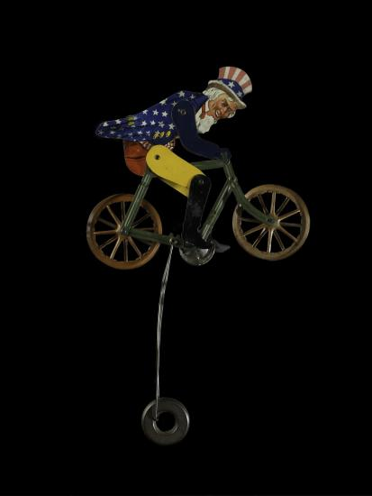 Uncle Sam toy on spinning wheel