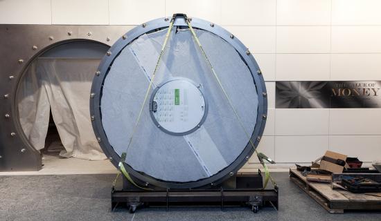 Round vault door sits in front of installed frame