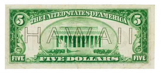 "The back of a standard $5 US bill with ""HAWAII"" written in text across it."