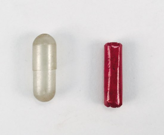 Small pill-shaped object and even smaller object next to it.
