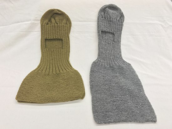 Knitted item in army green with space for your face to stick out