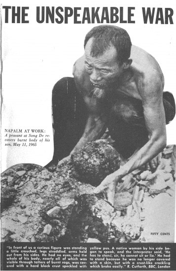 A thin, shirtless man in black pants kneels above what appears to be charred human remains
