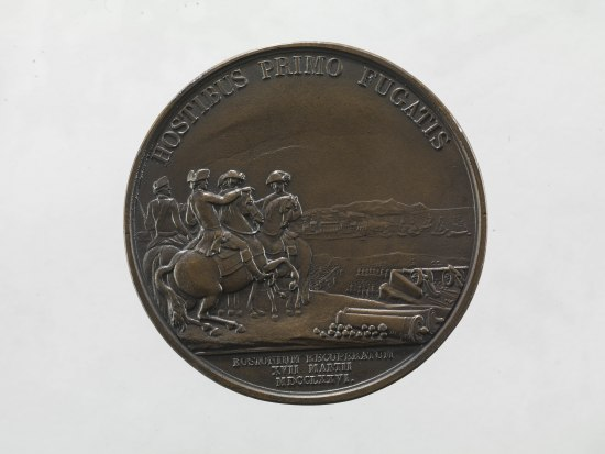 Coin with men on horses