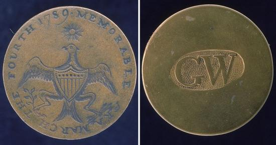 "Photo of two sides of a button, one with eagle and the other with ""GW"" text"