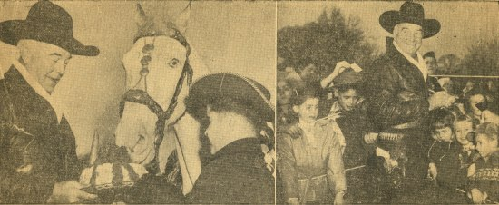 A yellowed newspaper clipping reporting on Boyd's visit to the Graham School. In one photo, he and a young person in a cowboy hat feed cake to a horse. In another image, he is surrounded by young children.
