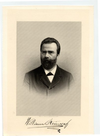 A man with a beard and glasses