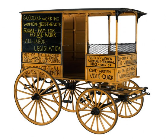 Yellow and black wagon decorated with woman suffrage slogans