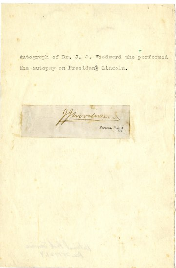 Piece of paper with message: Autograph of Dr. J. J. Woodward who performed the autopsy on President Lincoln. A scrap of paper with Woodward's signature is attached.