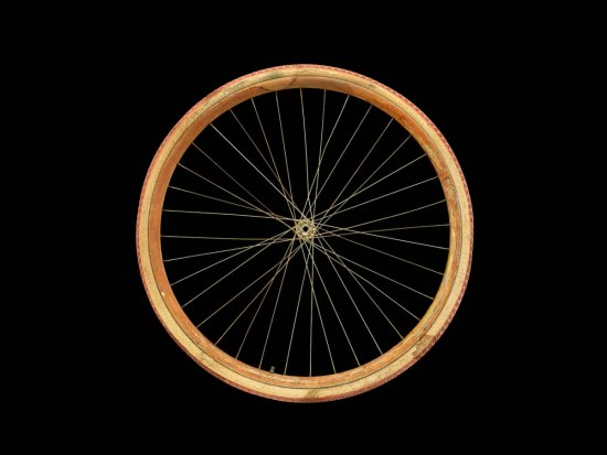 Photo of a bicycle wheel with spokes and a rubber tire