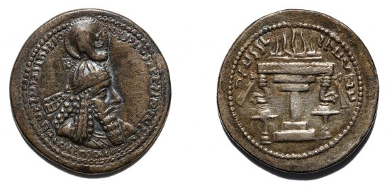 Two sides of a bronze coin, showing a man with a helmet and a bounty of hair and an altar-like structure with text and votives on the reverse