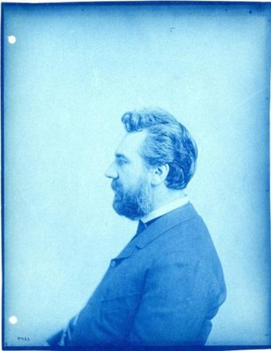 Photograph of Alexander Graham Bell, seated