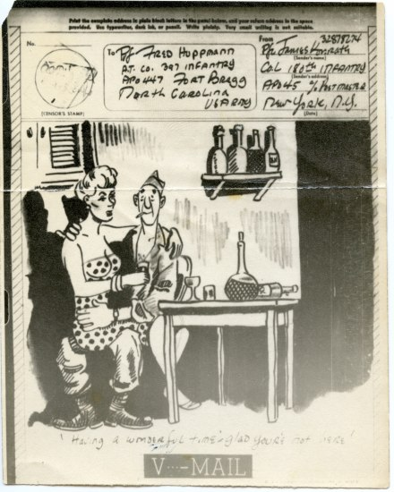 "A piece of ""V-Mail"" that resembles a postcard. Addresses are in the upper righthand corner and there is a cartoon of a soldier sitting at a table with wine and a busty blonde woman in a polka dot dress in his lap. He has a cigarette in his mouth and looks happy."