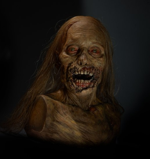 Zombie prop with open mouth and bloodshot eyes