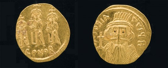 A gold coin with men on both sides. One side has them walking in a procession while the reverse has a bearded man with something on his head
