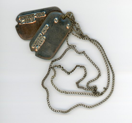 Two dog tags on a chain.