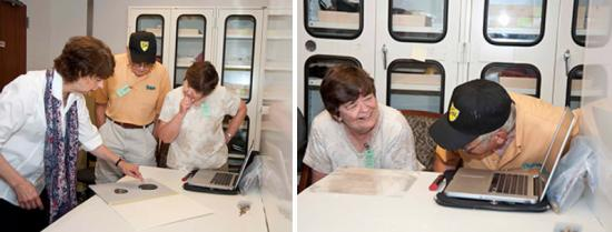 A curator shows John and Ellen the original recordings, John and Ellen listen to the recordings play on a laptop