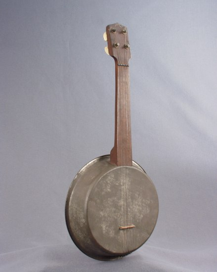 A banjo with weathered wood and metal frame