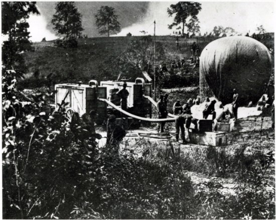 Black and white image with trees, machinery, and people