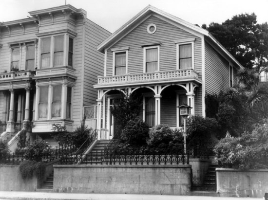 A black and white shot of exteriors of several houses