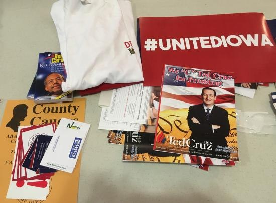 Various materials from Iowa related to the 2016 primary, such as Ted Cruz's book, signs saying #UnitedIowa, tshirts, pamphlets for Ben Carson, etc.