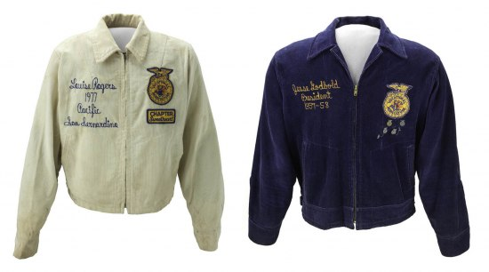 Against a blank white background, a white corduroy jacket with insignia and stitching is posed next to a similar blue jacket.