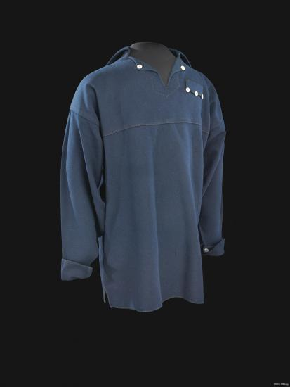 Blue jumper with buttons at collar