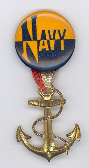 "A button that says ""Navy"" in orange and navy blue. A gold anchor hangs down from the button."