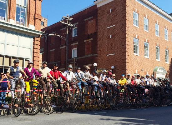 Penny stack at the Frederick high wheel bicycle race