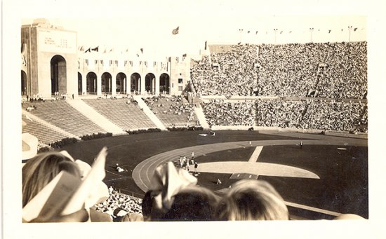 An old photograph depicting a stadium or coliseum full of people