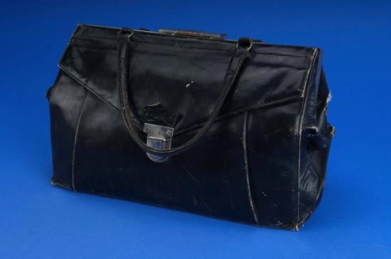 Black purse with shoulder strap and clasp