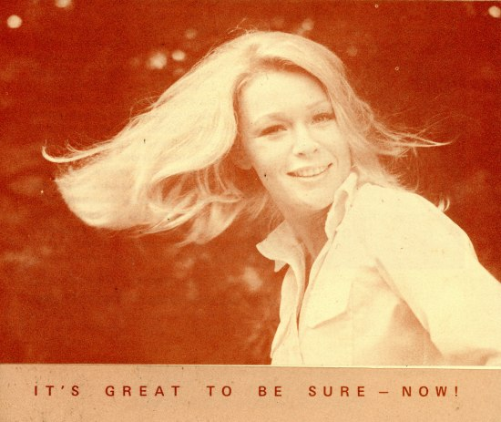 "A blonde woman is pictured smiling and swinging her hair on this monochromatic red brochure. Under her picture are the words ""It's Great To Be Sure - Now!"""
