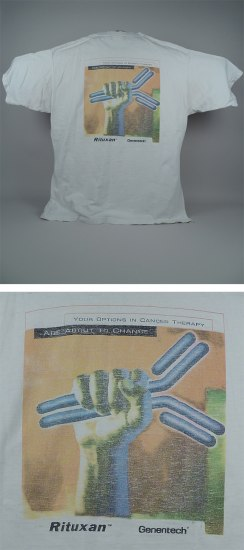 Combined images of a white shirt with an illustration of an upstretched fist holding an object looking like metal bars, then a close up of the shirt illustration.