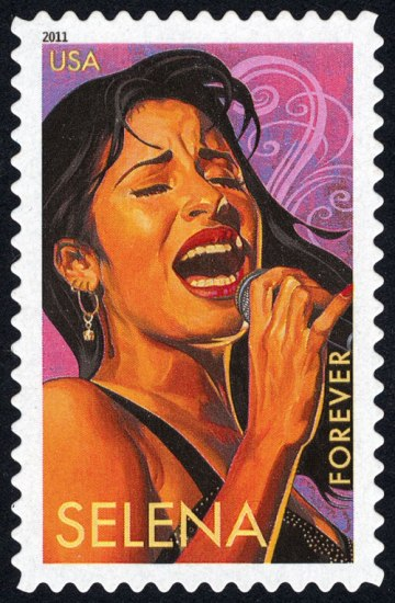 A rectangular stamp positioned vertically depicting a young woman with long dark hair singing into a microphone with her eyes closed